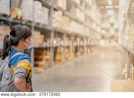 The Asian Girl Wearing Surgical Mask With The Backpack For  Shopping The Decorate Funiture For Inter