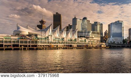 Vancouver, British Columbia/canada - July 11, 2019: View Of The Sun Setting Over Canada Place, The C