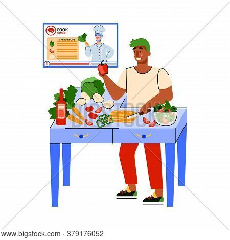 A Man Watches An Online Cooking Channel. Blogger Tells Recipes For Cooking Healthy Dishes. Cooking A