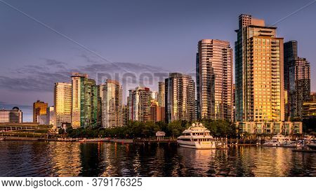 Vancouver, British Columbia/canada - July 11, 2019: Sunset Over The High Rise Buildings Along The Sh