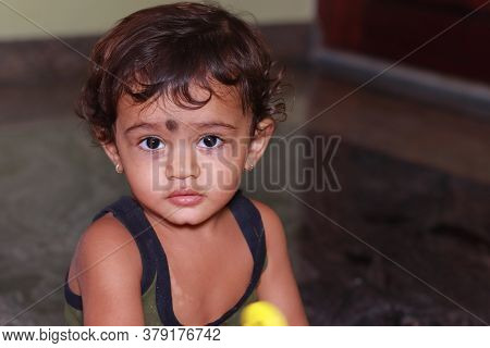 A Indoors Child (baby , Boy, Children) Looking At The Camera, Child Portrait Image , Child Face