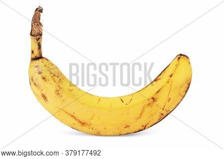Banana With Dark Spots With Shadow Isolated On White Background. Closeup,