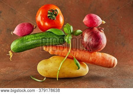 A Gourmet Food Composition With Colorful Vegetables On A Brown Background, For A Fun Gastronomy And