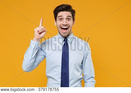 Excited Young Business Man In Classic Blue Shirt Tie Posing Isolated On Yellow Background. Achieveme