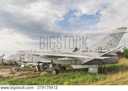 Old Jet Plane Stands At An Abandoned Airfield