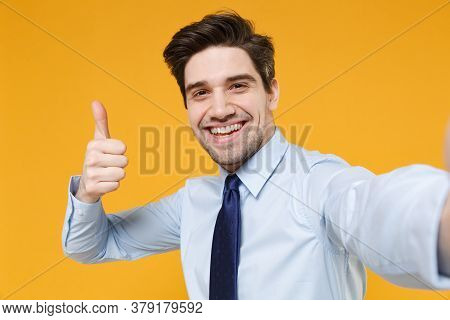 Close Up Of Smiling Young Business Man In Classic Blue Shirt Tie Isolated On Yellow Background Studi