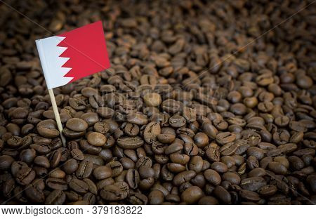 Bahrain Flag Sticking In Roasted Coffee Beans. The Concept Of Export And Import Of Coffee