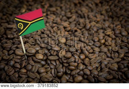 Vanuatu Flag Sticking In Roasted Coffee Beans. The Concept Of Export And Import Of Coffee