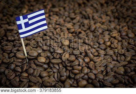 Greece Flag Sticking In Roasted Coffee Beans. The Concept Of Export And Import Of Coffee