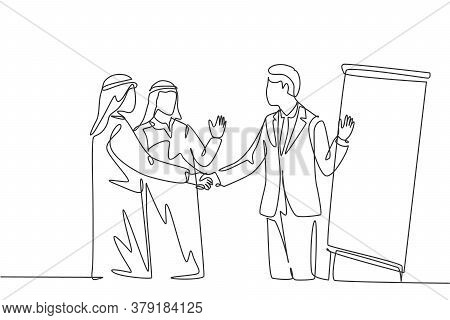 One Continuous Line Drawing Of Young Muslim Business Man Handshake His Partner After Meeting Present