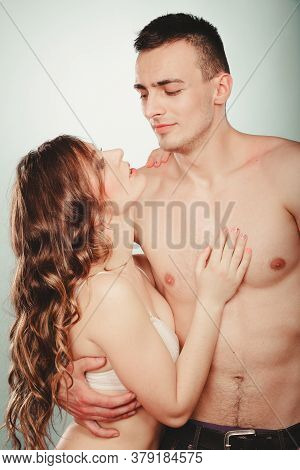 Sexy Passionate Couple In Studio. Handsome Half Naked Semi Nude Man And Pretty Woman In Lingerie. Lo