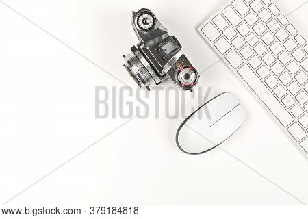 Retro Analog Slr Camera Next To Computer Keyboard And Mouse On White Background, Digital Photography
