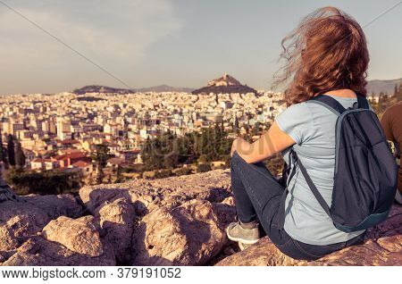 Young Person On Background Of Urban Landscape Of Athens, Greece, Europe. Adult Pretty Girl Tourist R