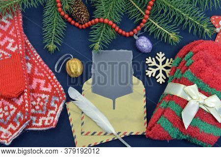 Still Life With Knitted Socks And Mittens, Post Envelope And Quill With Conifer. Letter To Santa. Ch