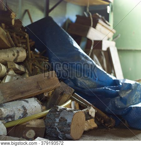Firewood And Pvc Foil In A Shed Or Garage, Indoor Shot