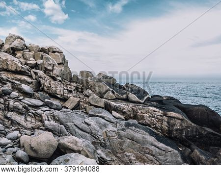 Huge Yellow Strange Stone And Sea. Alien Planet Landscape, Rock Formations. Dramatic Toned Photo For