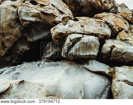 Huge Yellow Strange Stone Near Sea. Alien Planet Landscape, Rock Formations. Dramatic Toned Photo Fo