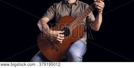 Classical Guitarist Plays Piece Of Music. Men Musician Plays Classical Guitar. Guitarist Isolated On