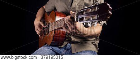Flamenco Guitarist Plays Piece Of Music. Men Musician Plays Classical Guitar. Beautifull Woodem Acou