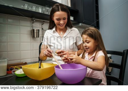 Mother And Daughter Are Making Cookies In Kitchen.