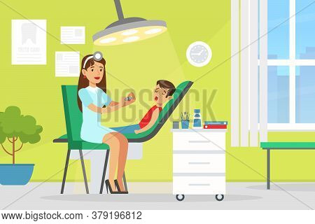 Pediatric Dentist Examining And Treating Boy Tooth, Doctor Woman Doing Medical Examination Of Kid, M