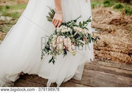 Wedding Bouquet Of The Bride In Womens Hands. Wedding Flowers. Bridal Bouquet Of Fresh Flowers, Wedd