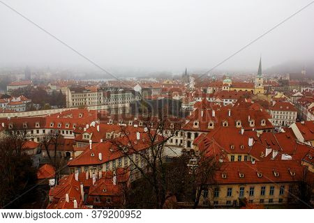 Red Roofs Of Prague On A Foggy Day. Prague City View From Above. Panorama Of Prague On A Foggy Day.