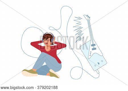 Joyful Boy Wearing Earphones And Headphones, Listening To Electric Guitar Rock Music. Happy Young Ma