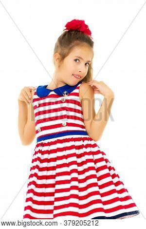 Beautiful Little Girl Posing In The Studio. Childrens Emotions Concept. Close-up. Isolated On White