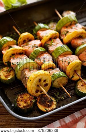Grilled Salmon Skewers With Zucchini And Herb Marinade In A Grill Pan Close Up View