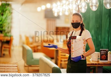 Waiter Hold Menu In Protective Mask In The Restaurant.