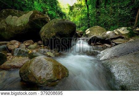 Rock Or Stone At Waterfall. Beautiful Waterfall In Jungle. Waterfall In Tropical Forest With Green T