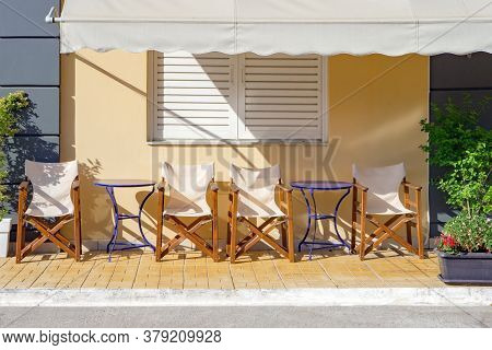 Hotel, Resort Waiting For Visitors, Customers, Clients. Cafe Exterior Background. Table And Empty Ch