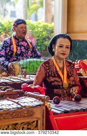 Jakarta, Indonesia - November, 02, 2017 Couple Playing Music On Tradiitonal Indonesian Instruments