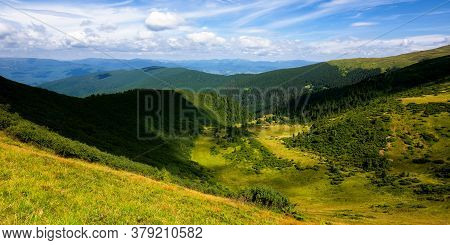 Hills And Valley Of Summer Mountain Landscape. Sunny Weather With Clouds On The Blue Sky. Beautiful