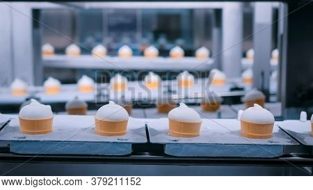 Icecream Automatic Production Line - Conveyor Belt With Ice Cream Cones At Modern Food Processing Fa