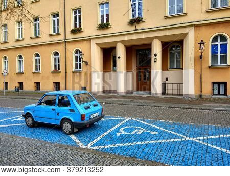 Wroclaw, Poland - December 8, 2017: Blue Fiat 126 Car Parks On The Parking Space Reserved For Person