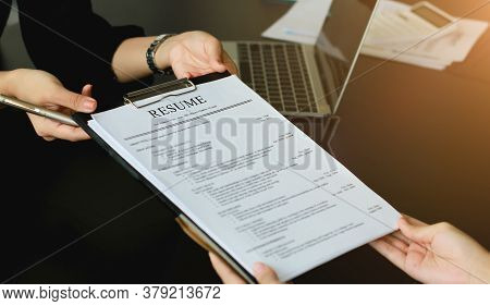 A Young Woman Sends A Resume To A Human Resource Manager To Consider The Application. The Human Reso
