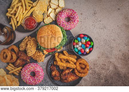 Fast Food Assortment. Junk Food Concept. Unhealthy Food For The Heart, Teeth, Figure.