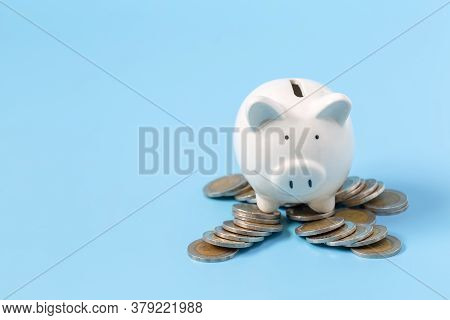 Picky Bank And Coin On A Blue Background, Invest Money, Ideas For Saving Money For Future Use.
