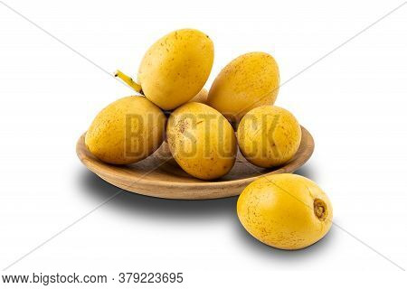 Bunch Of Freshly Harvested Date Fruit In A Wooden Plate On White Background With Clipping Path.