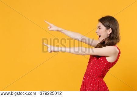 Side View Of Funny Young Brunette Woman Girl In Red Summer Dress Posing Isolated On Yellow Wall Back