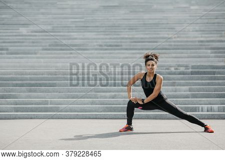 Young Woman And Active Workout Outdoor. Happy African American Girl In Sportswear With Fitness Track