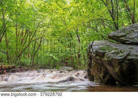The Roaring Rock Stream In Warren County Nj Passes By This Huge Glacial Stone.