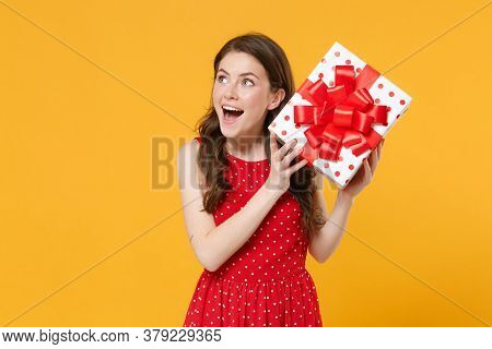 Excited Young Woman Girl In Red Summer Dress Posing Isolated On Yellow Wall Background Studio Portra