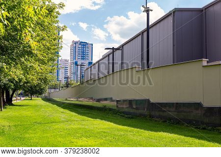 Green Grass Lawn And Secured High Fenced Area With Secutity Cctv Cameras Ofresidential Apartment , O