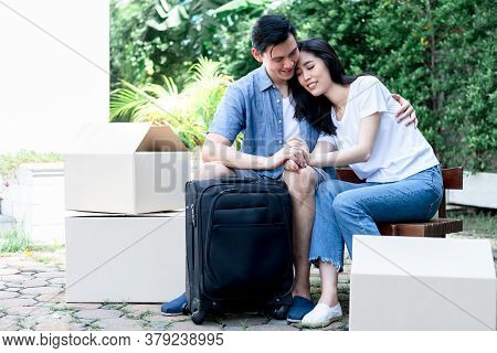 Asian Husband Are Embracing And Holding Hand Attractive Wife With Bags And Boxes On The Floor They A