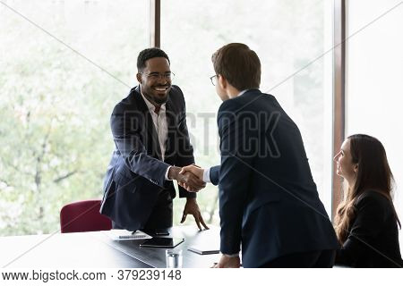 Multiethnic Business Partners Start Group Meeting Shake Hands Express Regard