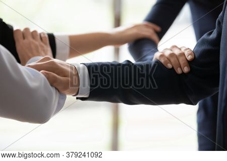 Businesspeople Standing Shoulder By Shoulder Showing Unity Closeup Image