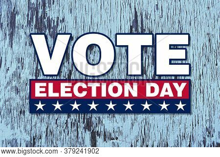 America Vote Election Day Graphic With White Text And Stars Red Box With Faded Blue Wood Announcemen